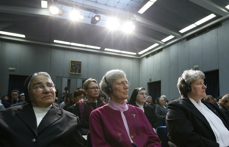 Nuns listen during Vatican press conference for release of final report of Vatican-ordered investigation of U.S. communities of women religious.