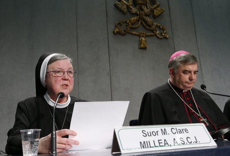 Sister Mary Clare Millea, then superior general of the Apostles of the Sacred Heart of Jesus, speaks on Dec. 16, 2014 at a Vatican press conference for release of the final report of a Vatican-ordered investigation of U.S. communities of women religious. Sister Millea was the Vatican-appointed director of the visitation. At right is Archbishop Jose Rodriguez Carballo, secretary of the Vatican's Congregation for Institutes of Consecrated Life and Societies of Apostolic Life. (CNS photo/Paul Haring)