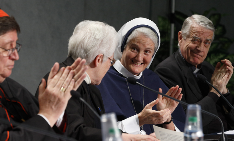 Sister Sharon Holland, president of the Leadership Conference of Women Religious, receives applause at Vatican press conference for release of final report of Vatican-ordered investigation of U.S. communities of women religious.