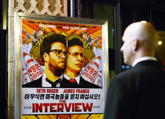 Security guard stands at United Artists theater during premiere of film 'The Interview' in Los Angeles