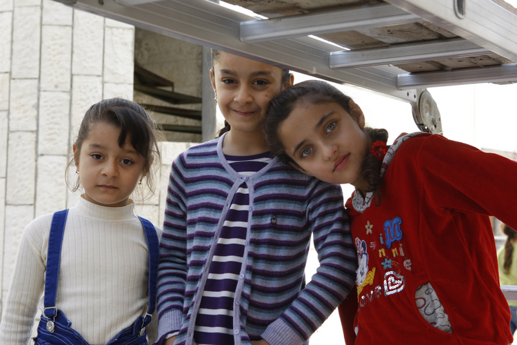 raqi refugee children pose outside the Syriac Catholic Church of Our Lady's Assumption in Amman, Jordan, in late October. A Catholic official warned that funding will soon run out for the refugees, who fled Islamic State militants. (CNS photo/Barb Fraze )