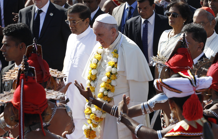 Pope Francis walks with President Maithripala Sirisena as the pontiff arrives at the international airport in Colombo, Sri Lanka, Jan. 13. (CNS photo/Paul Haring)