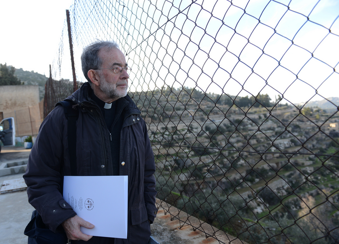 Canadian bishop looks through fence at convent in Beit Jalla, West Bank.