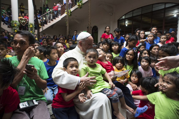 Pope Francis pictured with youths at home for former street children in Manila.