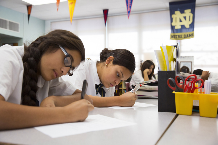 Eighth-grade students Brianna Navarro and Amaya Grijalva work on an assignment at St. Ambrose Catholic School, a Notre Dame ACE Academy, in Tucson, Ariz., Oct. 23, 2014. (CNS photo/Nancy Wiechec)