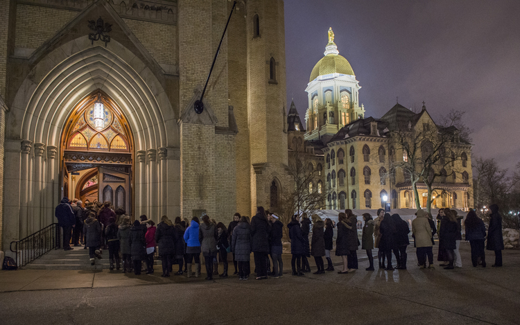 Students wait in line to pay respects at visitation for Holy Cross Father Theodore Hesburgh at University of Notre Dame