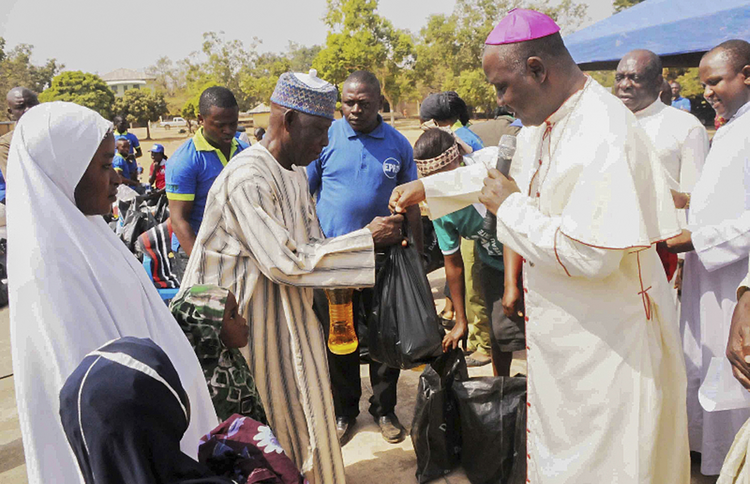 Nigerian archbishop presents relief material to internally displaced people in Jos, Nigeria
