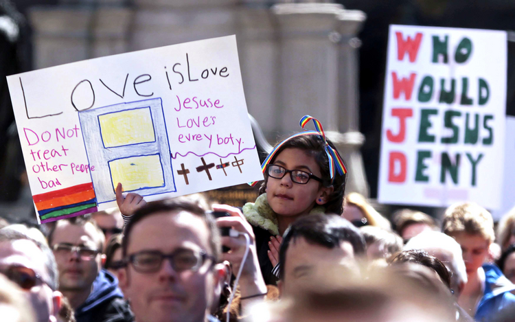 Demonstrators rally at Monument Circle in Indianapolis March 28 to protest a religious freedom bill signed in to law by Indiana Gov. Mike Pence. (CNS photo/Nate Chute, Reuters)