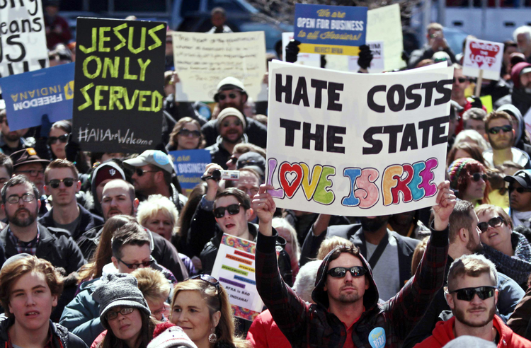 Demonstrators gather in Indianapolis to protest new religious freedom law.