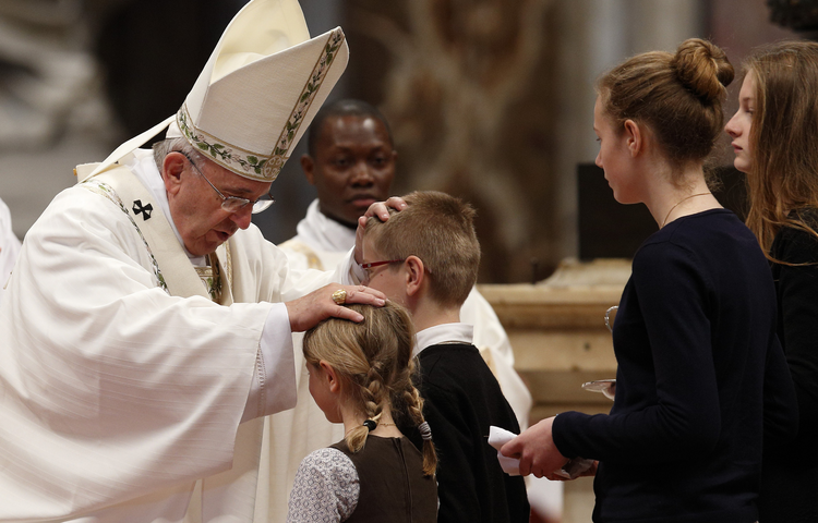 Pope Francis greets children in offertory procession at Holy Thursday chrism Mass in St. Peter's Basilica at Vatican.