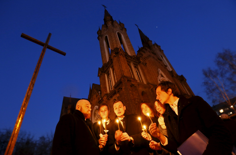People light candles in front of a Catholic church during the Easter vigil in the Siberian city of Krasnoyarsk, Russia, April 4. (CNS photo/Ilya Naymushin, Reuters)