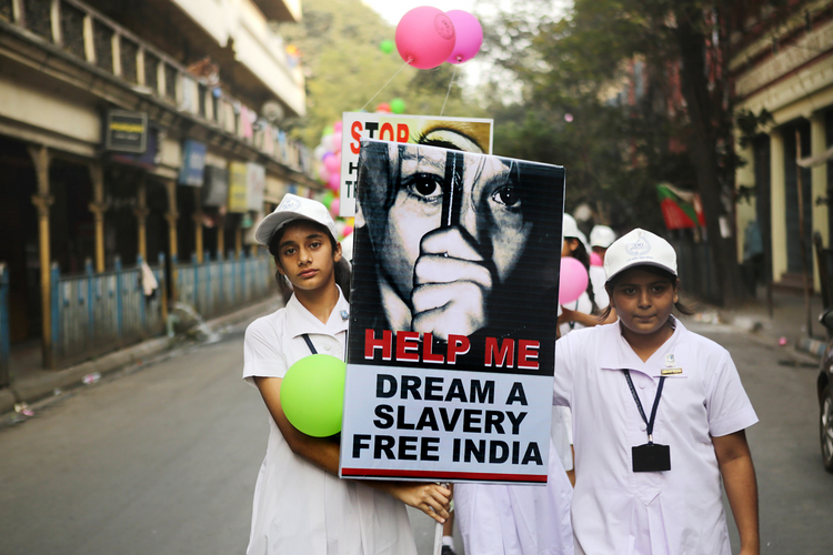 Students from the Archdiocese of Calcutta take part in a walk for peace against human trafficking in early February in Kolkatta, India. (CNS photo/Piyal Adhikary, EPA)