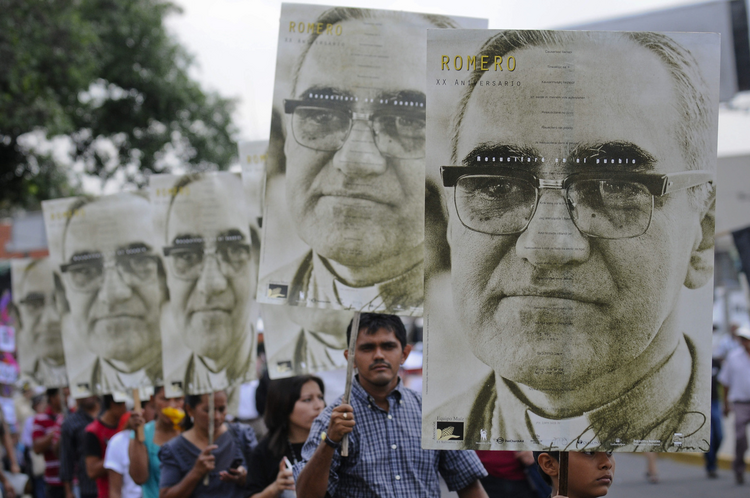 People carry portraits of Salvadoran Archbishop Oscar Romero during rally in his honor in San Salvador.
