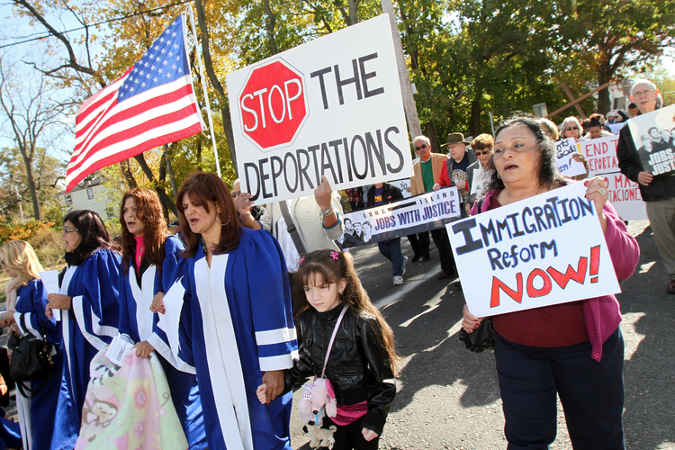 An interfaith march in 2013 in Wyandanch, N.Y., calls for immigration reform. (CNS photo/Gregory A. Shemitz)