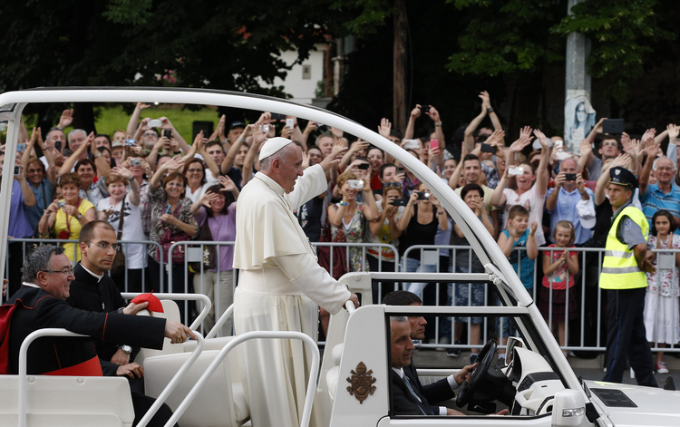 Pope Francis greets crowd as he arrives for meeting with young people in Sarajevo, Bosnia-Herzegovina.