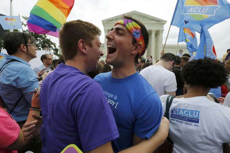 Gay rights supporters celebrate outside the U.S. Supreme Court building in Washington June 26 after the justices ruled in a 5-4 decision that the U.S. Constitution gives same-sex couples the right to marry. (CNS photo/Jim Bourg, Reuters)