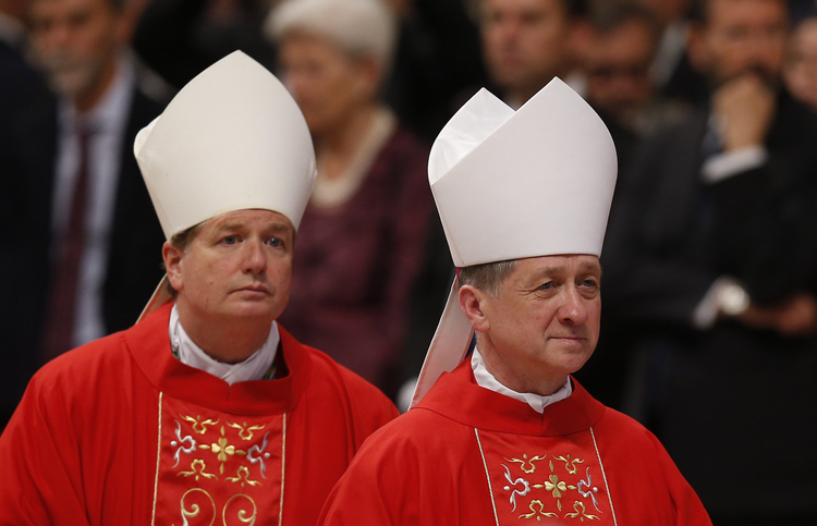 Archbishops Fisher, Cupich leave after Mass marking feast of Sts. Peter and Paul in St. Peter's Basilica at Vatican.