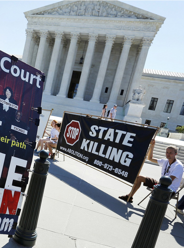 Protesters against the death penalty gather in front of the U.S. Supreme Court building in Washington June 29. (CNS photo/Jonathan Ernst, Reuters)