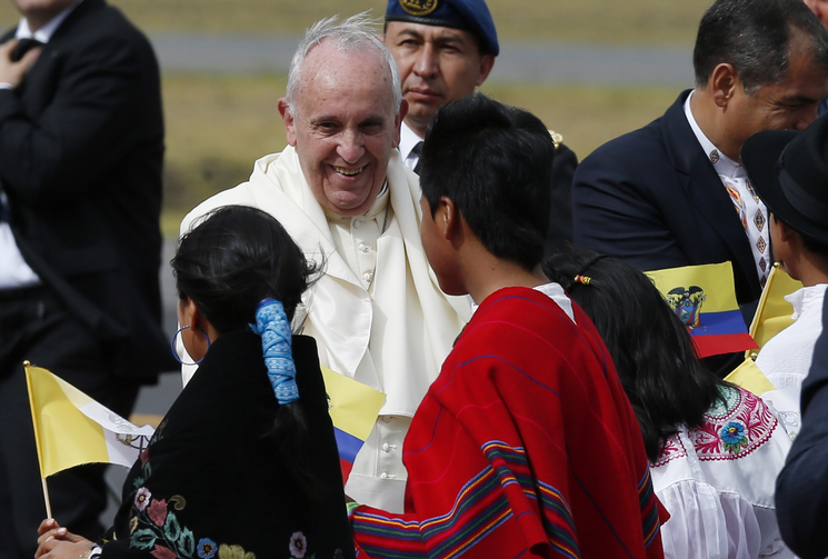 Pope Francis greets children in traditional dress as he arrives at Mariscal Sucre International Airport in Quito, Ecuador, July 5. The pope is making an eight-day trip to Ecuador, Bolivia and Paraguay. (CNS photo/Paul Haring)