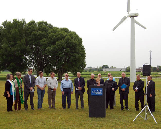 "FOLLOWING FRANCIS. Iowa Catholic and other religious leaders and clean energy advocates convene to urge action on environmental issues in light of ""Laudato Si'"" on July 2."