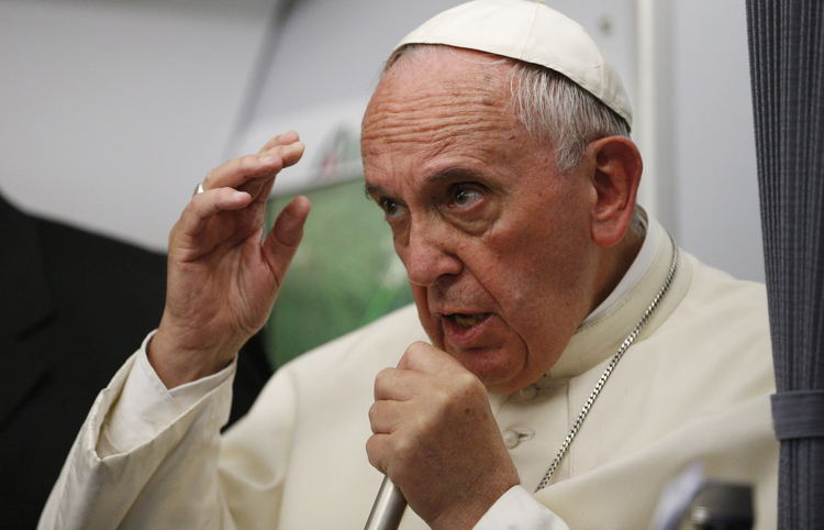 Pope Francis answers questions from journalists aboard his flight from Asuncion to Rome July 12. (CNS photo/Paul Haring)