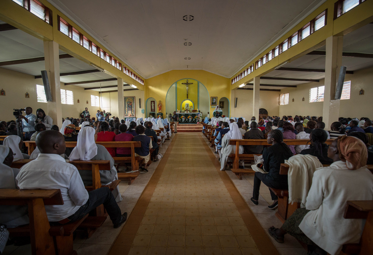 Worshippers pray inside a Catholic church in Nyeri, Kenya, in May 2015. (CNS photo/Stuart Price, EPA)
