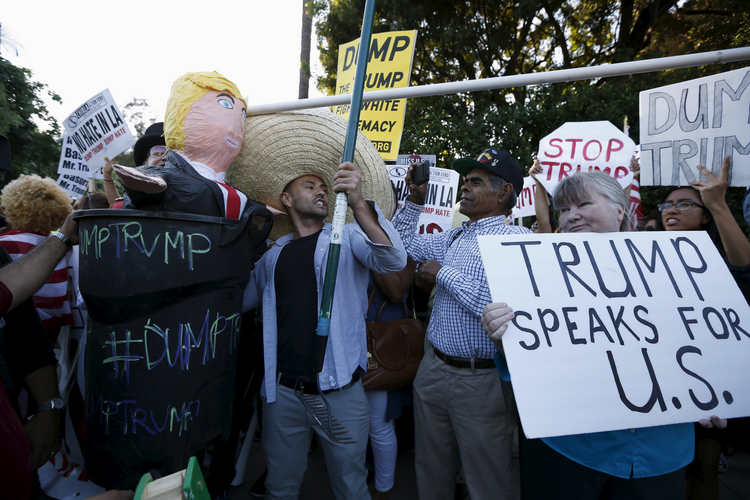 Opponents and supporters of Republican presidential candidate Donald Trump demonstrate outside a Los Angeles hotel in July. (CNS photo/Lucy Nicholson, Reuters)