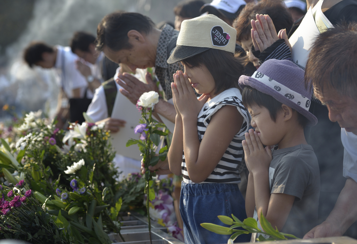 After pictured August 6 prayer service in memory of Hiroshima bombing, Japanese again gather to mourn largest mass killing since 2008 (CNS photo/Paul Jeffrey)