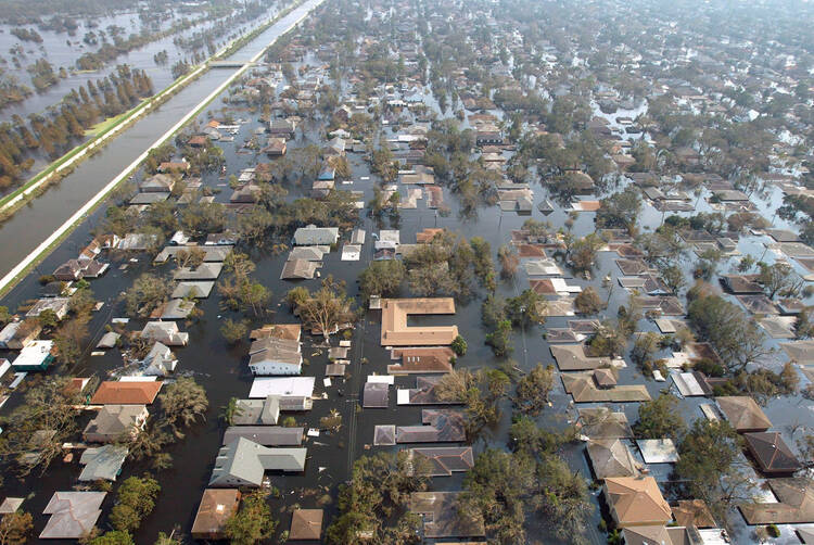 Houses in New Orleans are seen under water Sept. 5, 2005, after Hurricane Katrina swept through Louisiana, Mississippi and Alabama. More than a decade after the storm, New Orleans continues to rebuild. (CNS photo/Allen Fredrickson, Reuters)
