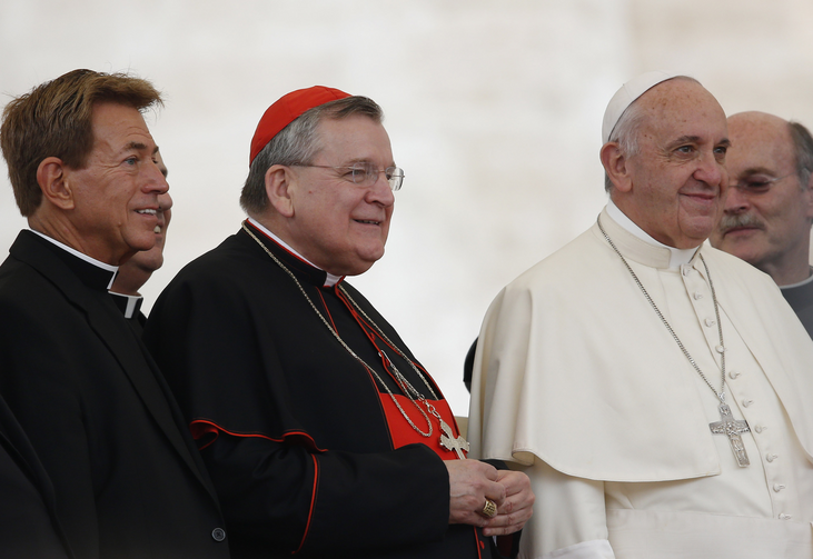 U.S. Cardinal Raymond L. Burke, patron of the Knights and Dames of Malta, center left, and a group of priests pose with Pope Francis during his general audience in St. Peter's Square at the Vatican Sept. 2. (CNS photo/Paul Haring)