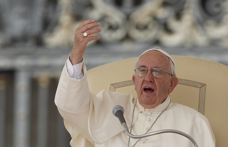 Pope Francis gestures as he speaks during his general audience in St. Peter's Square at the Vatican Sept. 9. (CNS photo/Paul Haring)