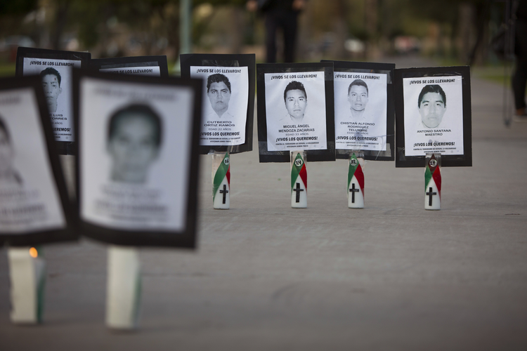Images of college students who went missing in Mexico's Guerrero state are set outside the Arizona State Capitol in Phoenix by immigration reform advocates in this file photo from Nov. 20, 2014. (CNS photo/Nancy Wiechec)