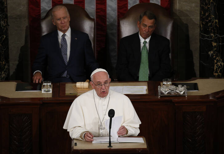 Pope Francis addresses a joint meeting of the U.S. Congress as Vice President Joe Biden (left) and Speaker of the House John Boehner look on in the House of Representatives Chamber at the U.S. Capitol in Washington Sept. 24, 2015. (CNS photo/Paul Haring)