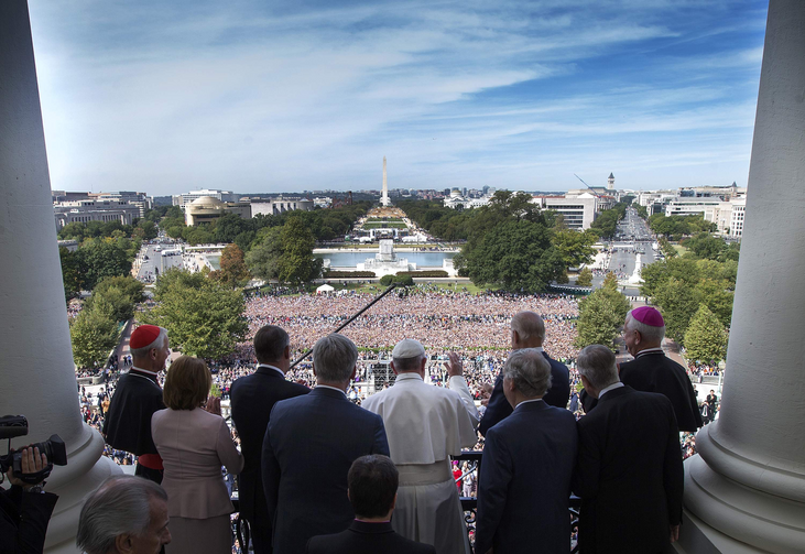 Pope Francis is welcomed to the Speakers Balcony at the U.S. Capitol by members of Congress Sept. 24. (CNS photo/Doug Mills, pool)