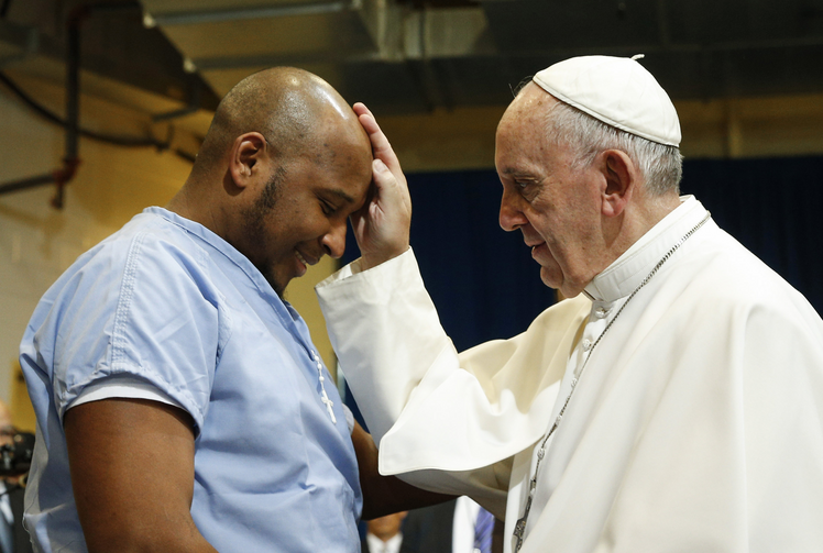 Pope Francis blesses a prisoner as he visits the Curran-Fromhold Correctional Facility in Philadelphia in September 2015. (CNS photo/Paul Haring)