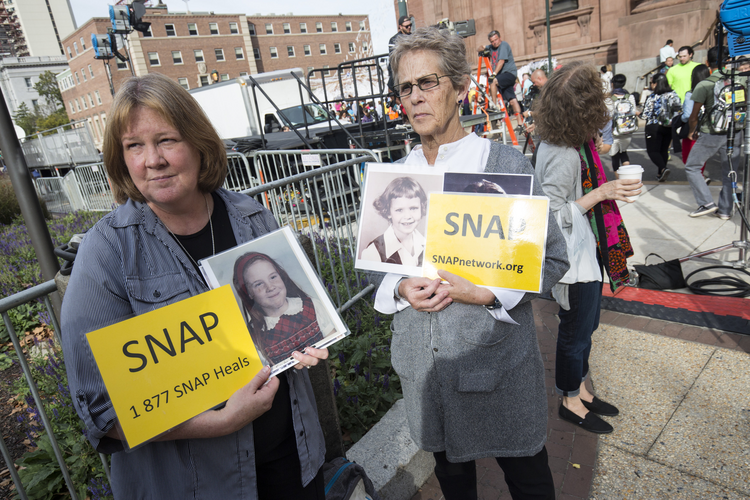Members of Survivors Network of those Abused by Priests demonstrate in front of the Cathedral Basilica of SS. Peter and Paul in Philadelphia Sept. 25, 2017, while Pope Francis met privately with a group of survivors of sexual abuse (CNS photo/Joshua Roberts).