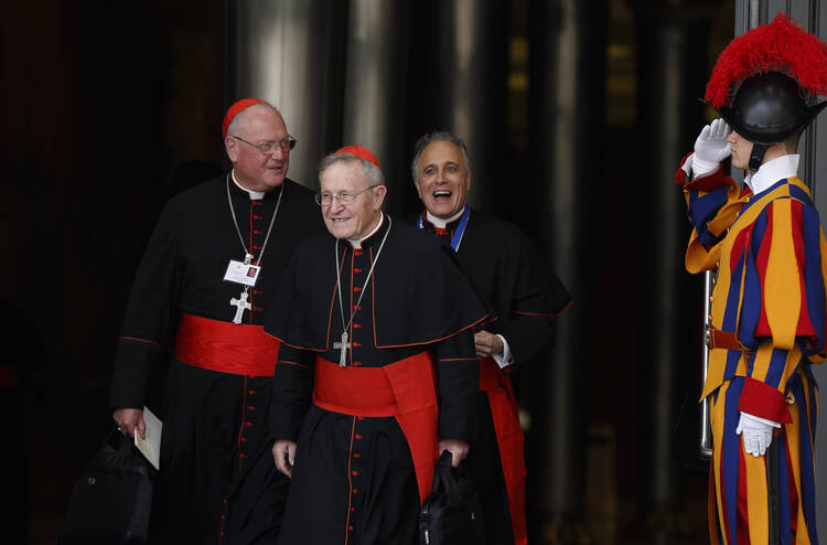 Cardinals Dolan, Kasper and DiNardo leave opening session of Synod of Bishops on the family at Vatican