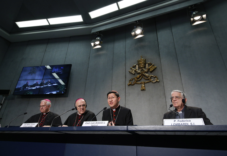 Prelates and the Vatican spokesman give a media briefing after the morning session of the Synod of Bishops on Oct. 9 (CNS/Paul Haring)