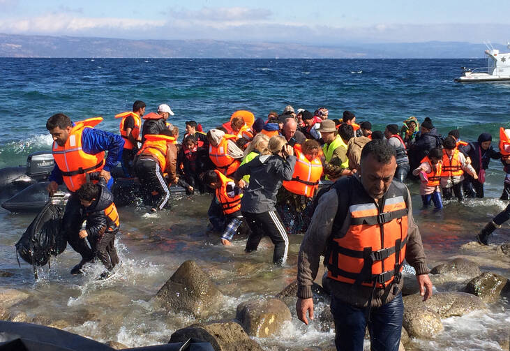 Migrants from Syria arrive on the Greek island of Lesbos Oct. 2 after crossing the Aegean Sea from Turkey. (CNS photo/Dale Gavlak)
