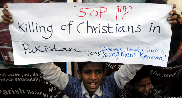 A Pakistani Christian boy holds a banner during a late March protest in Karachi after attacks on churches in Lahore last year.