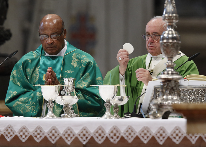 Pope Francis celebrates the Eucharist during the closing Mass of the Synod of Bishops on the family in St. Peter's Basilica at the Vatican Oct. 25. Concelebrating is Cardinal Wilfrid Napier of Durban, South Africa. (CNS photo/Paul Haring)