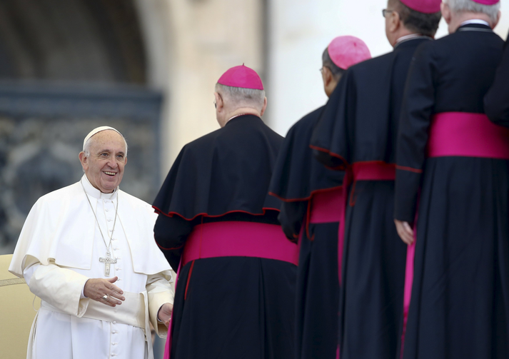 Pope Francis smiles as he greets prelates during his weekly audience in St. Peter's Square at the Vatican Oct. 28. (CNS photo/Stefano Rellandini, Reuters)