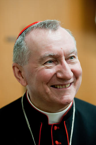 "Cardinal Pietro Parolin, Vatican secretary of state, smiles as he attends a conference commemorating the 50th anniversary of the Second Vatican Council's document, ""Nostra Aetate."" (CNS photo/M. Migliorato, Catholic Press Photo)"