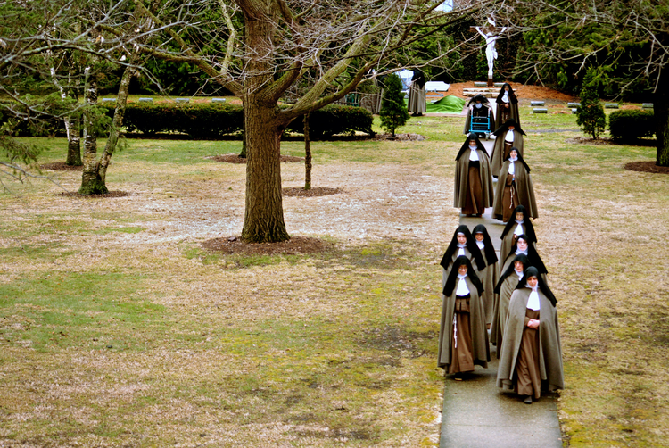 In this 2010 photo, Poor Clare Colettine nuns walk back to their Corpus Christi Monastery in Rockford, Ill., after a funeral service for one of the cloister's elderly sisters. (CNS photo/Abbie Reese)
