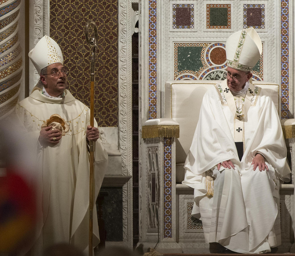 Pope Francis sits in the papal chair as he celebrates the ordination Mass of Bishop Angelo De Donatis, left, as an auxiliary bishop of Rome in the Basilica of St. John Lateran Nov. 9. (CNS photo/Claudio Peri, EPA)