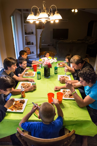 "A family that chooses to watch TV or play with their smartphones rather than talk at the dinner table is ""hardly a family,"" Pope Francis said. (CNS photo/Lisa Johnston, St. Louis Review)"