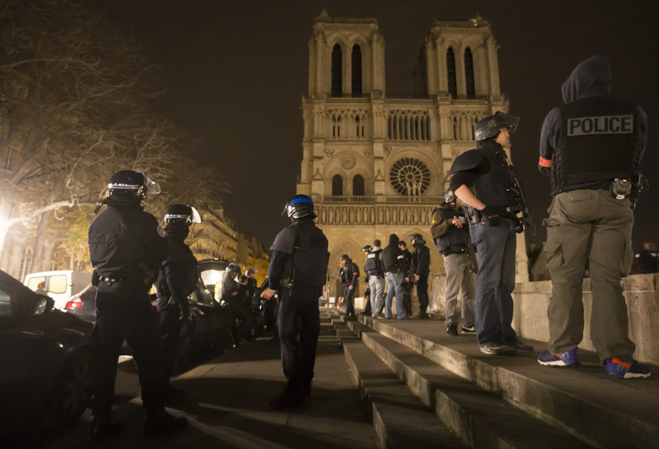 Armed police officers go on foot patrol around Notre Dame Cathedral in Paris Nov. 14. Dozens of people were killed in a series of attacks in Paris Nov. 13. (CNS photo/Ian Langsdon, EPA)