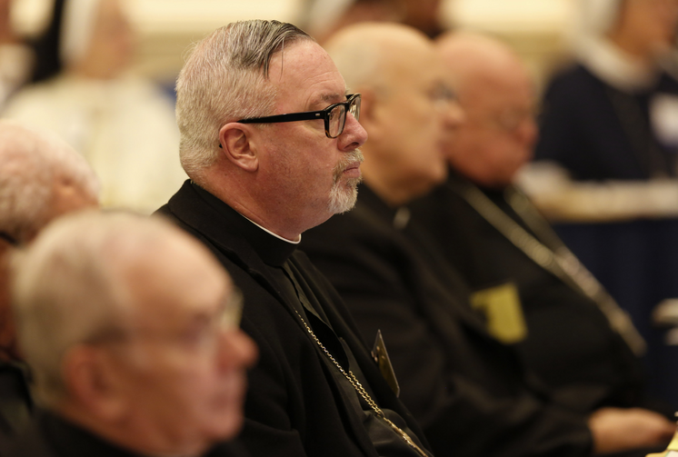 Bishop Christopher J. Coyne of Burlington, Vt., listens to a speaker Nov. 16 during the 2015 fall general assembly of the U.S. Conference of Catholic Bishops in Baltimore. (CNS photo/Bob Roller)
