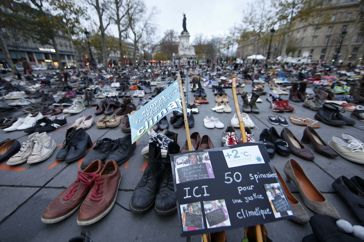 Pairs of shoes are symbolically placed on the Place de la Republique in Paris Nov. 29, ahead of the U.N. climate change conference, known as the COP21 summit, in Paris. (CNS photo/Eric Gaillard, Reuters)