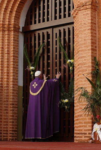 Pope Francis opens the Holy Door as he begins the Holy Year of Mercy at the start of a Mass with priests, religious, catechists and youths at the cathedral in Bangui, Central African Republic, Nov. 29. (CNS photo/Paul Haring)